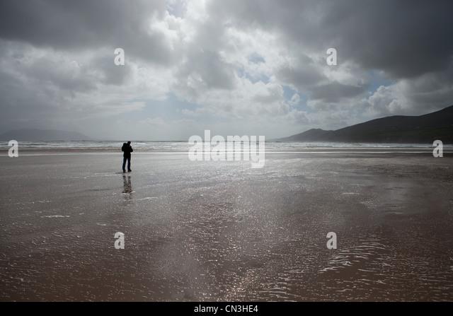 Man standing on beach - Stock Image