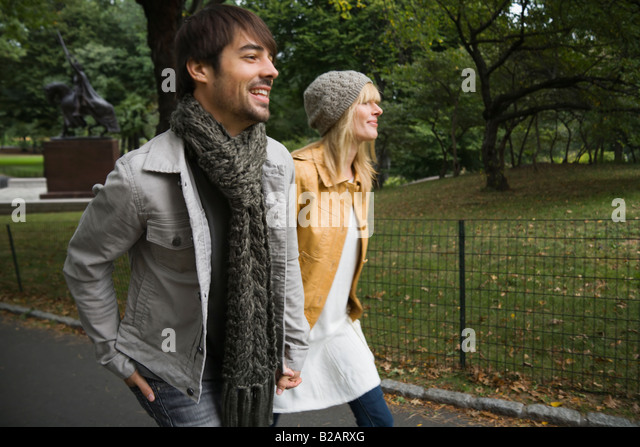 Couple on the move in Central Park - Stock Image