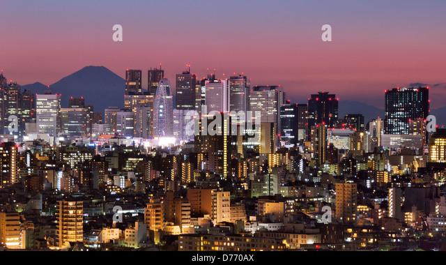 Skyline of Shinjuku, Tokyo, Japan with Mt. Fuji visible - Stock Image