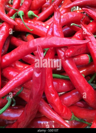 Red chillis on market - Stock Image