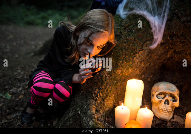 A young girl dressed in costume for Halloween Night. - Stock-Bilder