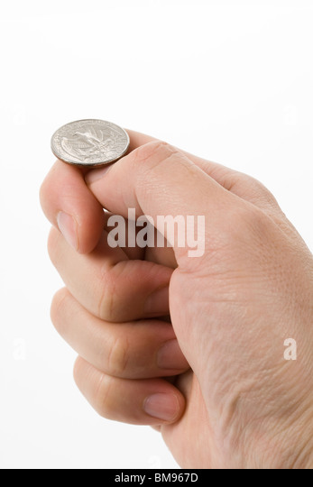flipping coin close up shot, concept of Decision - Stock Image