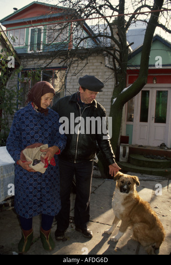 Ukraine Brovari former collective farm now privatized corporation manager mother dog home - Stock Image