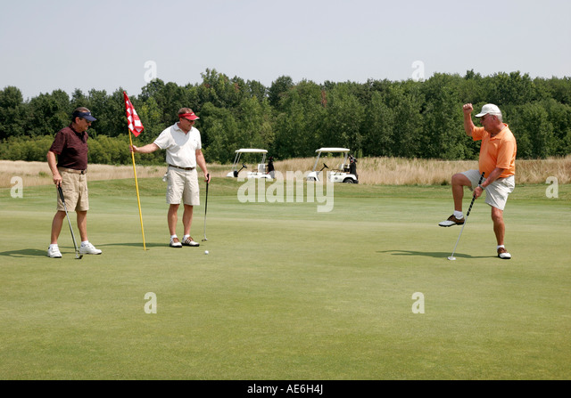 Toledo Ohio Oregon Maumee Bay State Park Scottish Links Golf Course male players green - Stock Image