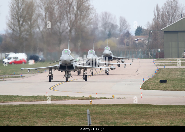 eurofighter typhoons in formation taxiing to main runway at RAF Coningsby lincolnshire head on view - Stock Image