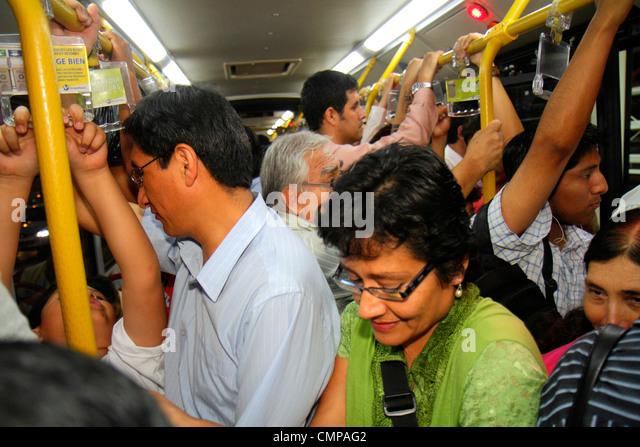 Peru Lima Avenida Emancipacion Metropolitano Bus Line public transport bus standing Hispanic man woman exit passenger - Stock Image