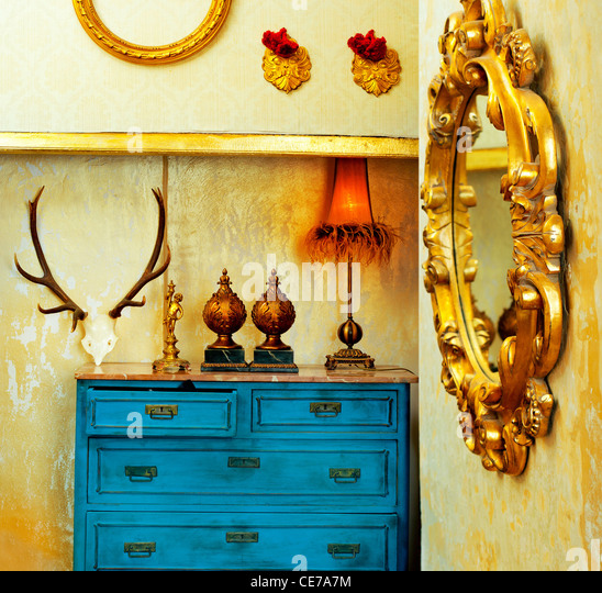 baroque grunge vintage house with blue drawer and golden mirror - Stock-Bilder