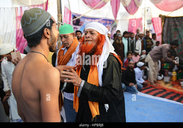 A Fakir father piercing his son during a Sufi festival in Uttar Pradesh, India. - Stock Image