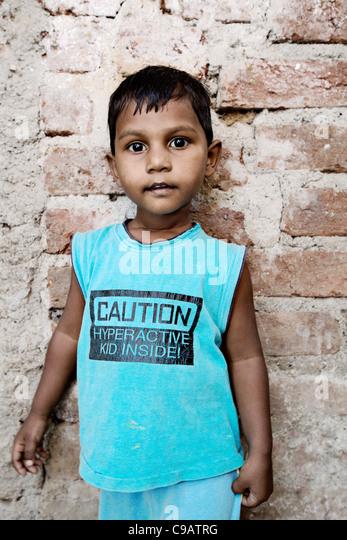 Small boy on street in Subash Nagar slum area in Mumbai, India. - Stock Image