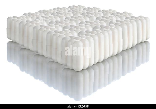 Multiple white capsules - Stock Image