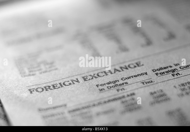 Foreign exchange section of business newspaper. - Stock Image