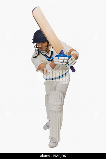 Cricket batsman playing shot - Stock Image