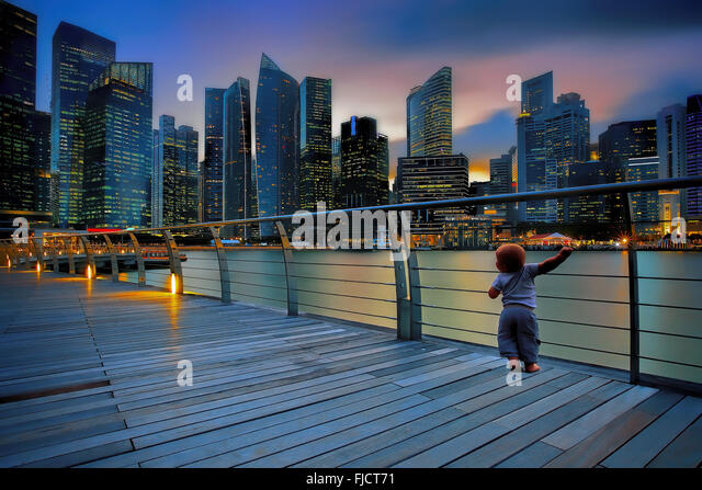 Little boy in a big city - Stock Image