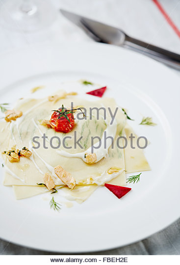 The modern way lasagna with trout. Restaurant serving. - Stock Image