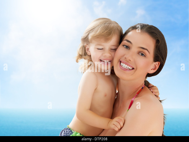 happy mother holding her child - Stock Image