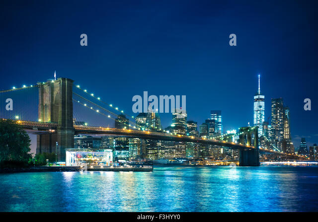 Beautiful night view of the Brooklyn Bridge looking towards Manhattan New York City - Stock Image