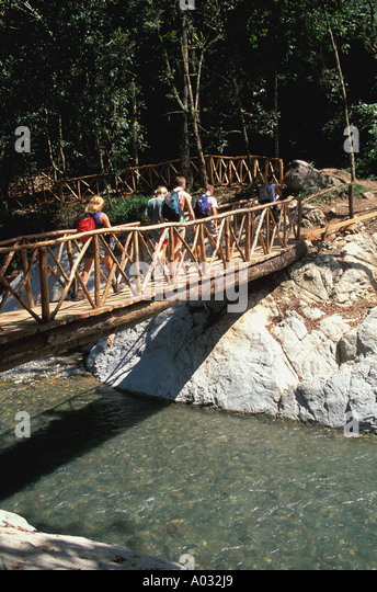 pico duarte hike Dominican Republic Bermudez National Park hikers crossing bridge - Stock Image