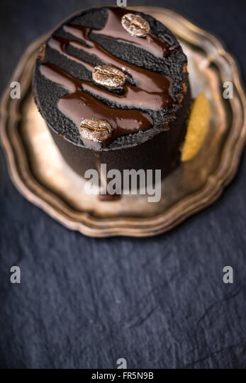 Chocolate mousse on vintage plate vertical - Stock Image