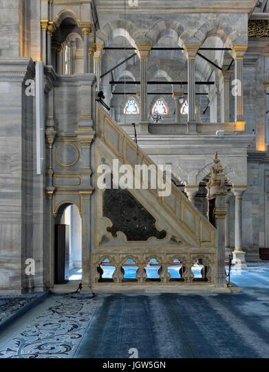 Side view of white marble floral golden ornate minbar (Platform) of Nuruosmaniye Mosque, Istanbul, Turkey - Stock Image
