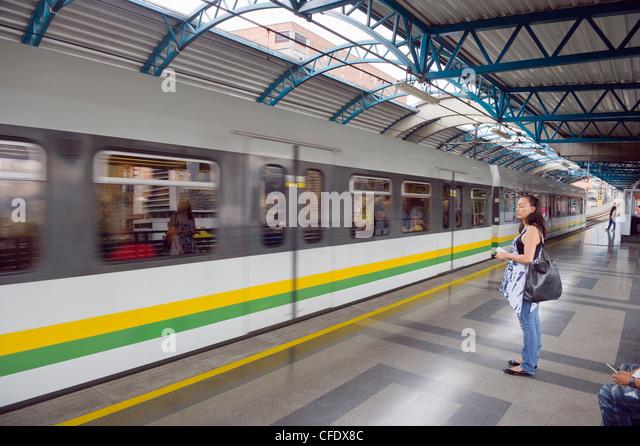 Metro line passengers, Medellin, Colombia, South America - Stock Image