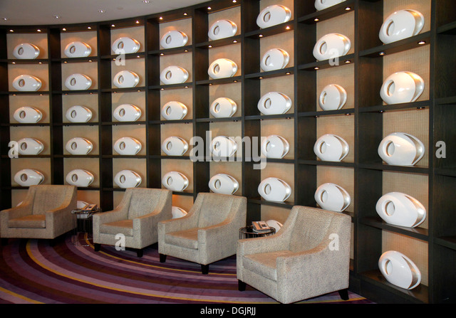 Miami Beach Florida Collins Avenue Fontainebleau Miami Beach hotel inside interior lobby seats art - Stock Image