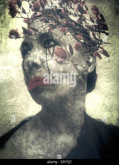 Double Exposure Portrait of a Woman and Magnolia Tree - Stock Image