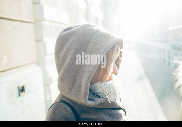 Side View Of Woman Wearing Hood - Stock Image