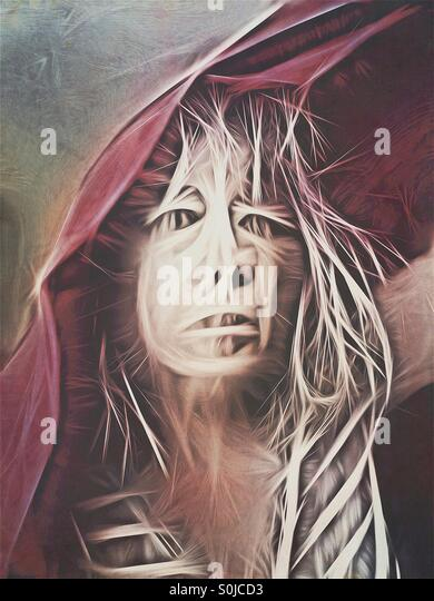 Macabre portrait of a monstrous woman with red cloak - Stock Image