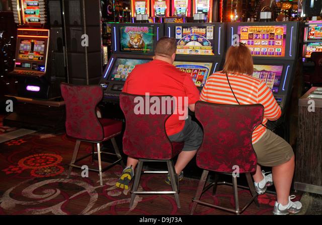 Nevada Las Vegas The Strip South Las Vegas Boulevard Cosmopolitan Hotel Las Vegas casino slot machine machines man - Stock Image