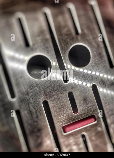Abstract face in a coffee machine grill - Stock Image