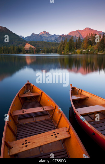 Wooden boats on Strbske Pleso lake in the Tatra Mountains of Slovakia, Europe. Autumn (October) 2011. - Stock Image