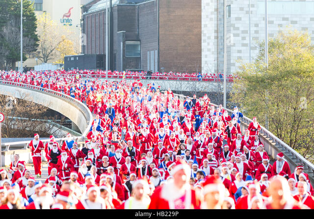 Liverpool, UK. 4th Dec, 2016. Thousands took part in a Santa Dash fun run in Liverpool city centre on Sunday, December - Stock Image