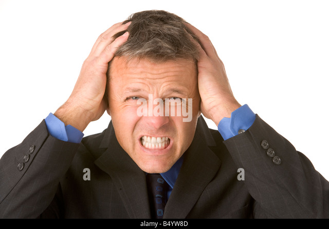 Businessman Looking Stressed - Stock Image