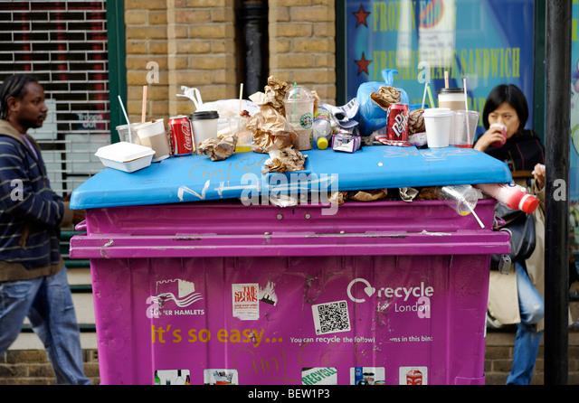 Overflowing recycling bin. Tower Hamlets. London. Britain. UK - Stock Image