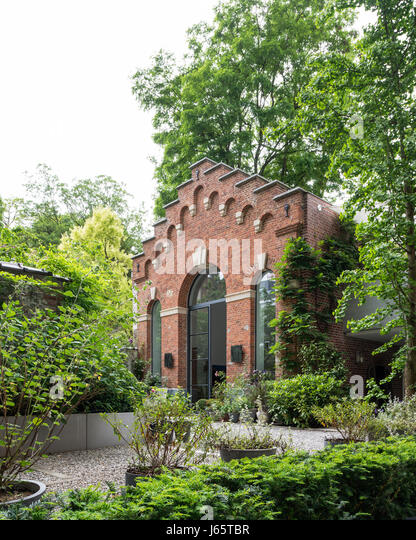 Triple-height brick facade of Isabelle de Borchgrave's Brussels atelier - Stock Image