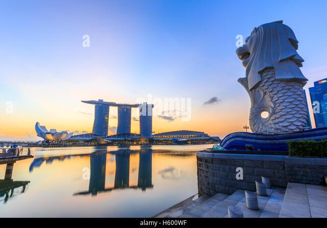 Singapore city skyline at sunrise. - Stock Image