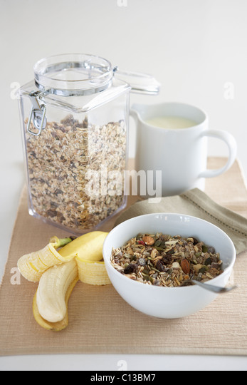A table setting of breakfast foods - Stock Image