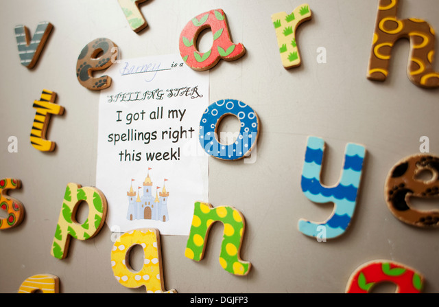 Letters and school certificate on wall - Stock Image