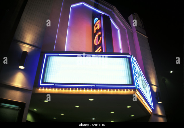ENTRANCE MOVIE THEATER FILM CINEMA NEON AWNING SIGN - Stock Image