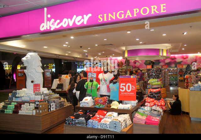 Singapore Changi International Airport SIN terminal concourse inside interior shopping front entrance Discover Singapore - Stock Image