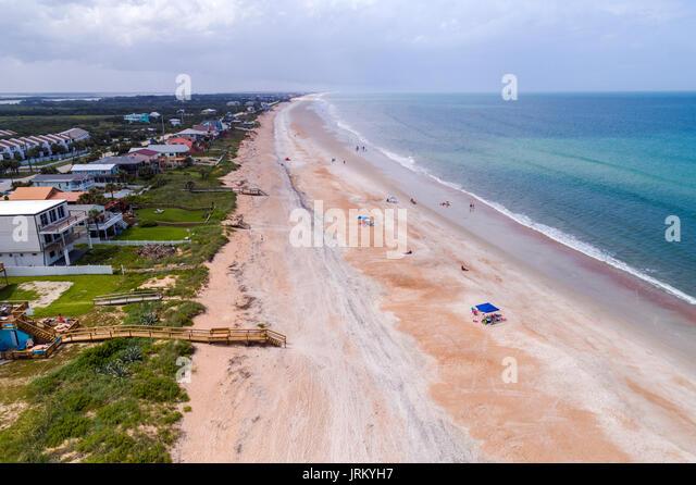 Florida Vilano Beach Surfside Park Atlantic Ocean sand aerial overhead view bird's eye above sunbathers beachfront - Stock Image