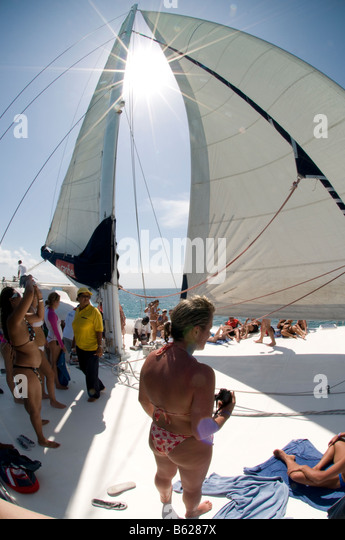 Caribbean Dominican Republic Punta Cana Passengers on sailboat Saona Island excursion - Stock Image