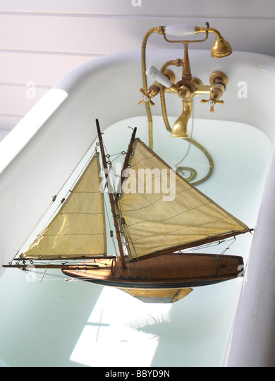 Toy sailing boat in bath - Stock Image