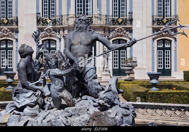 The National Palace of Queluz - Lisbon - Portugal. Neptunes Lake fountain in front of the Ceremonial Facade of the - Stock Image