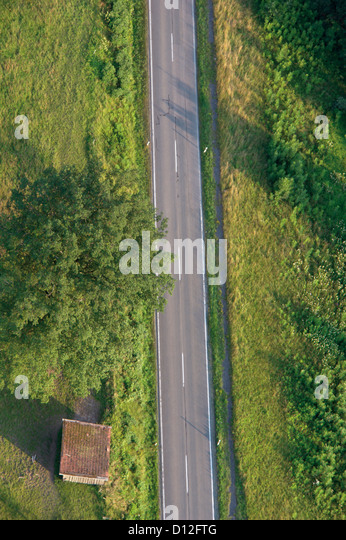 Germany, Bavaria, View of single track with lush landscape - Stock Image