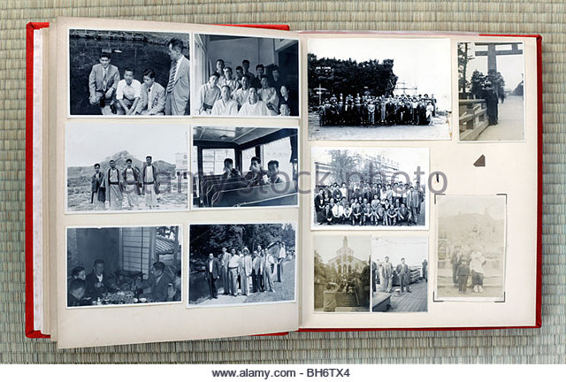open page of an old family photo album Japan Asia 1960s and earlier - Stock Image