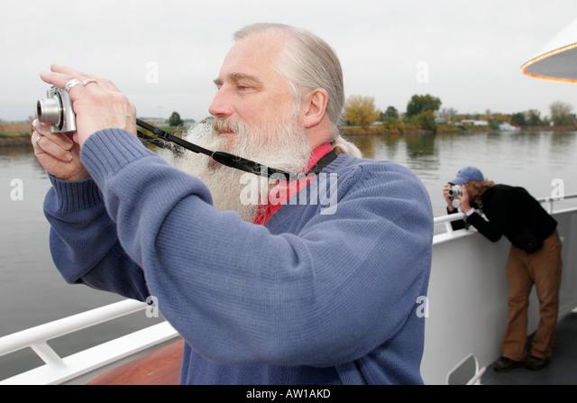 Wisconsin La Crosse Mississippi River Island Girl Yacht Cruise tour boat men digital camera - Stock Image