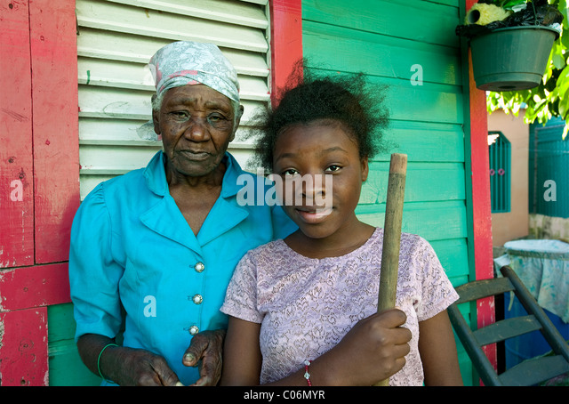 Locals outside house, Otrabanda, Dominican Republic - Stock Image