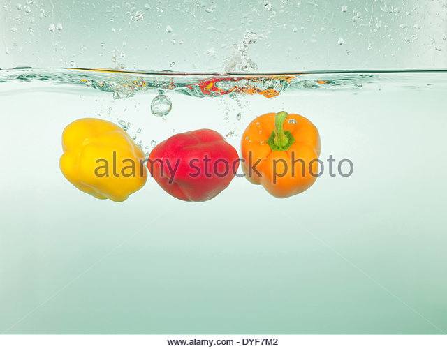 Bell peppers splashing in water - Stock Image