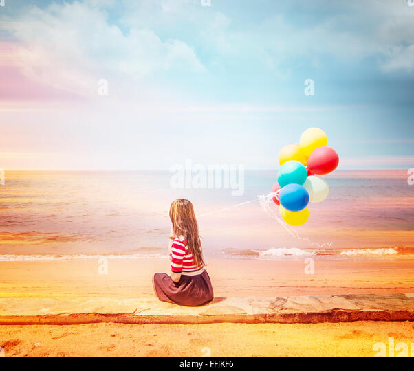 Woman with colorful Balloons on the beach,Outdoors lifestyle filters images - Stock Image